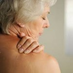 grey haired lady with shoulder pain